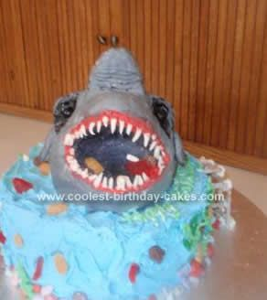 Homemade Scary Shark Birthday Cake: I started by making the Homemade Scary Shark Birthday Cake with a large batch of Rice Kripie treats. I formed it with my hands and carved the head and