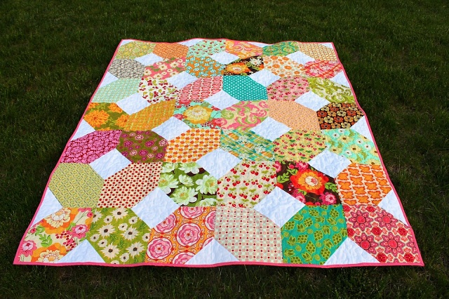 colorful X quilt by kelbysews