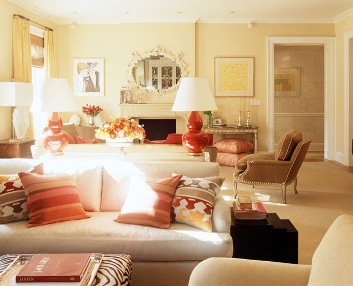 Salmon and Tan and Neutral with pale yellow walls. Notice the black stacking end tables and Zebra print ottoman. It works!