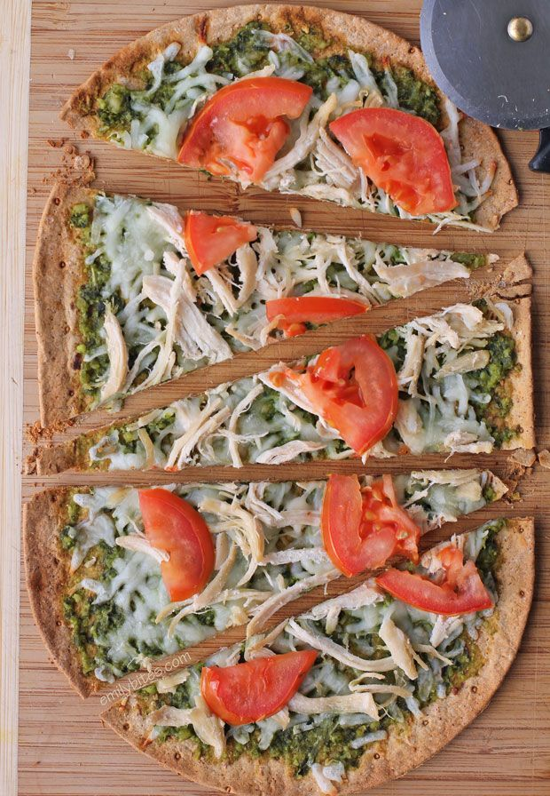 These healthy and delicious Chicken Pesto Flatbreads boast a thin, crispy crust, flavorful pesto, hearty chicken, Mozzarella cheese and juicy tomatoes! All the flavors you crave for just 282 calories or 7 Weight Watchers points! www.emilybites.com #healthy
