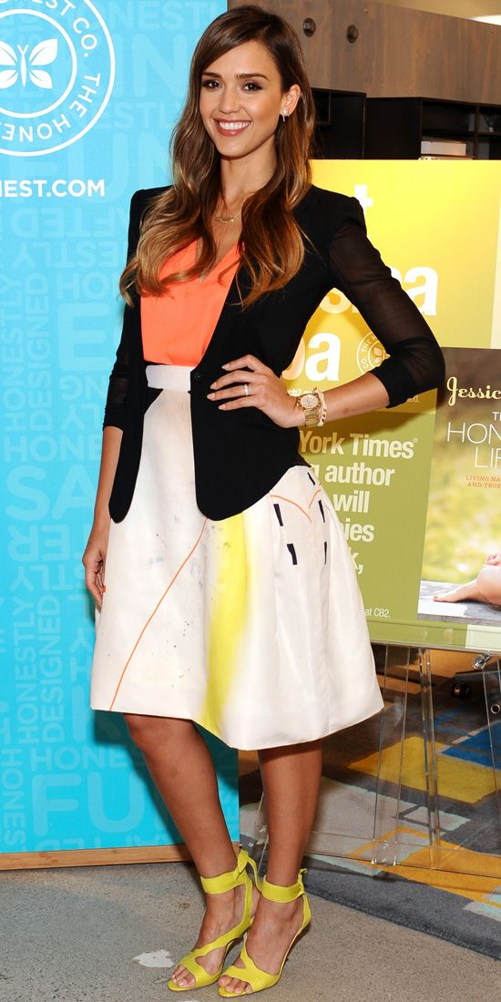 Jessica Alba spun her patterned A-line Carolina Herrera skirt into a summery outfit, teaming it with a coral top and yellow strappy ankle Brian Atwood tie-ups. A black jacket pulled her look together.