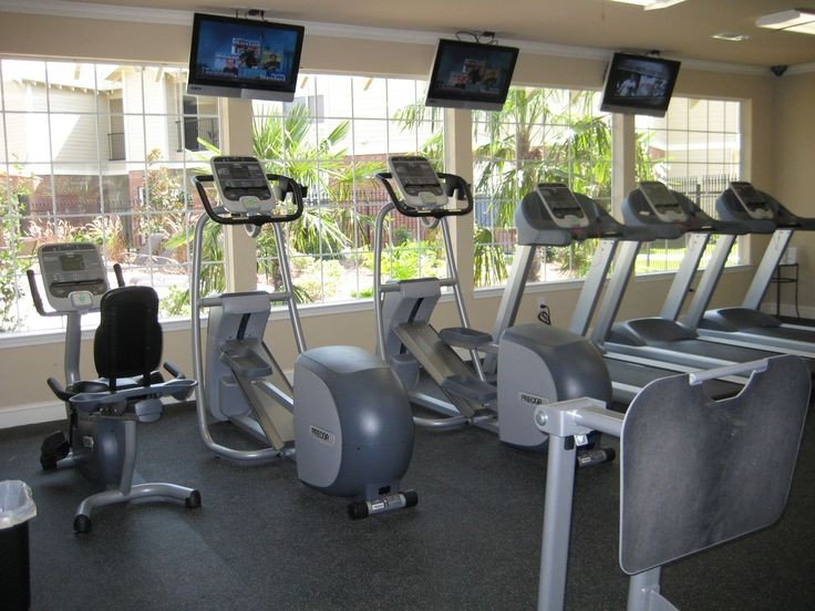 Fitness center by pool at Ivy Park Apartments