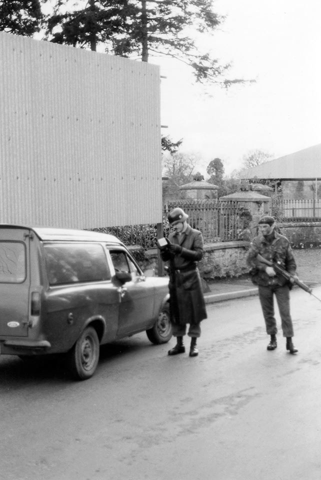 Allegedly taken at a checkpoint in the eighties in west Belfast. Paratroops playing at fancy dress...