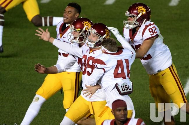 USC Trojans kicker Matt Boermeester (39) is mobbed by teammates after kicking a 46 yard game winning field goal to win the 2017 Rose Bowl…