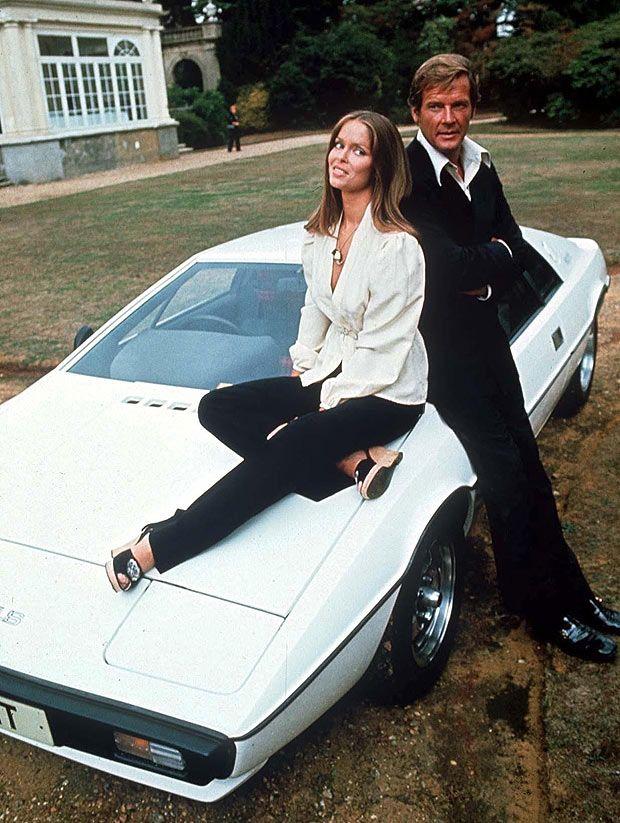 Roger Moore & Barbara Bach pose at Pinewood Studios with the Lotus car.