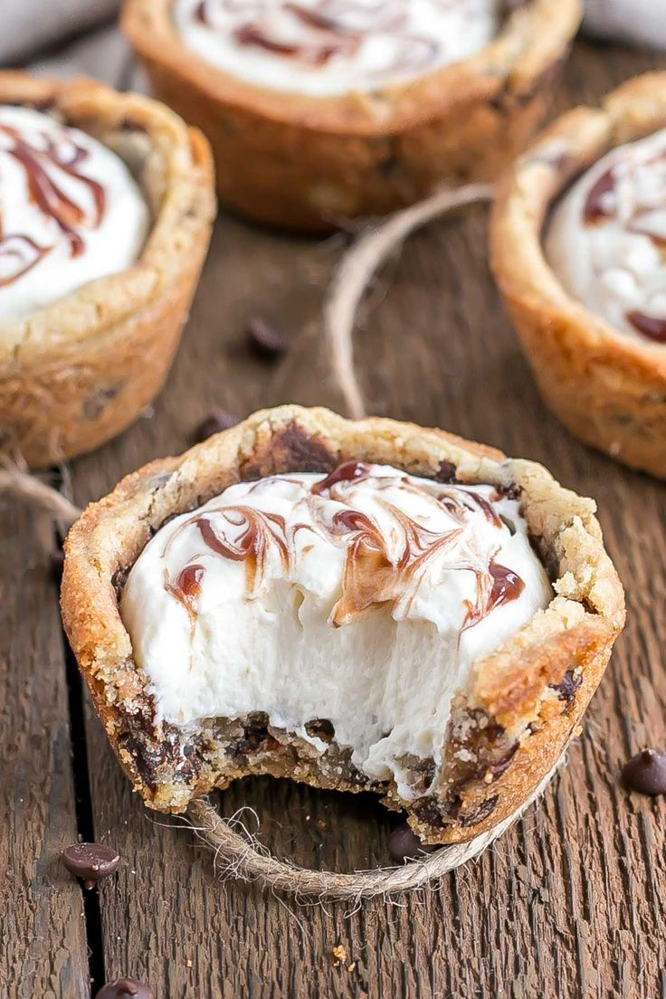 These chewy Chocolate Chip Cookie Cups are truly one of the easiest desserts you'll ever make. Filled with Vanilla Cream Cheese Mousse and a swirl of chocolate sauce.   livforcake.com