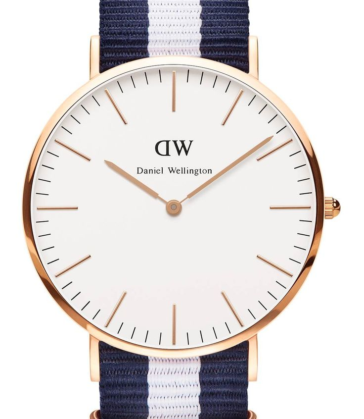 The Daniel Wellington Classic Glasgow men's watch is a beautifully designed, elegant and minimalist men's timepiece. This sophisticated watch features a blue and white NATO strap, a 40mm rose gold coloured stainless steel case and an eggshell white dial with gold coloured hands and markers.