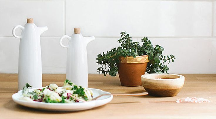Essential Kitchen Tools - 11 Creative Oil & Vinegar Dispensers // White ceramic oil and vinegar cruets make it easy to drizzle just the right amount of oil over salads or onto dishes being prepped.