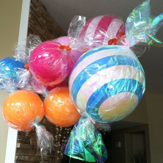 Candy Party Decorations: Wrapped bouncy balls in cellophane and twist tie on the ends. Looks like giant pieces of candy!