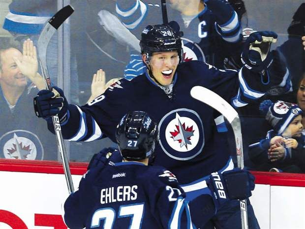 Nov.9 2016 - Patrik Laine takes NHL goal scoring lead with second hat trick of season, Winnipeg Jets thump Dallas Stars 8-2 - Jets rookie forward Patrik Laine celebrates his third goal of the game against the Dallas Stars with winger Nikolaj Ehlers during their game in Winnipeg on Tuesday night.