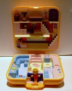 Vintage orange Polly Pocket town house - this was my favorite Polly pocket cause of the sectional couch and the bubble bath. Brings back sooo many memories!