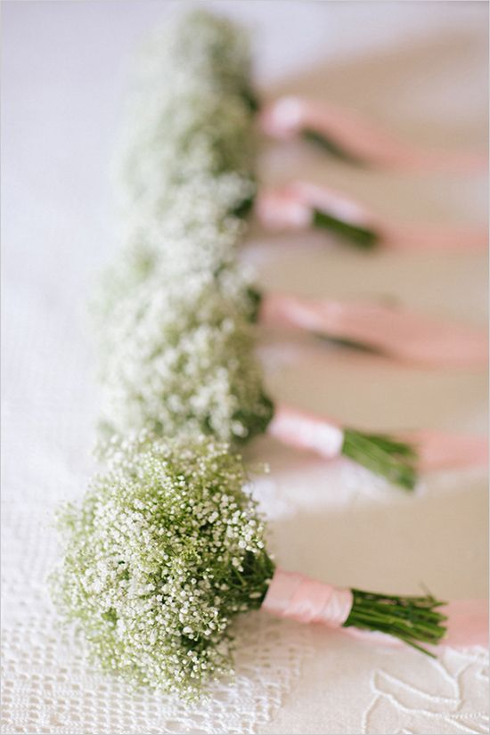 babys breath bouquets for bridesmaids with purple ribbon or ivory? I would have a purple bouquet. Groom wears ivory flowers and groomsmen wear purple or baby's breath?