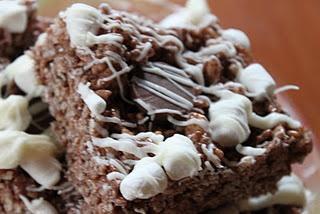 Kitchen Sink Cocoa Krispie Treats:  Marshmallows, Cocoa Krispies, Peanut Butter Cups& White Chcocolate!  Delicious!!!