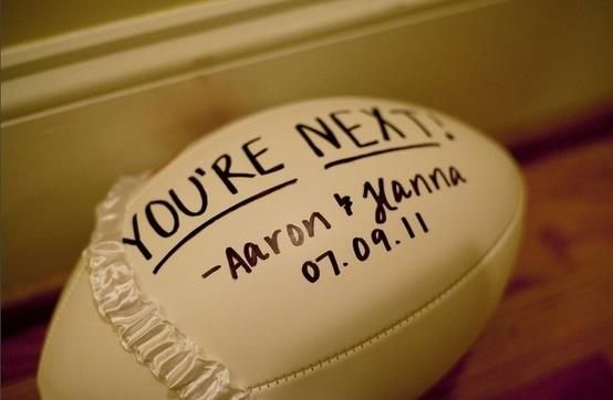 A fun idea to spice up the garter toss! Once the garter is 'retrieved' simply place onto a football. When the groom goes to throw the football, the guys will surely feel more manly trying to catch a football as opposed to a ladies garter! Adding a personal touch to this is easy with a white football and a cute saying on the football such as this one. Make sure that if you are throwing this inside a reception location, you have your groom take it easy when throwing