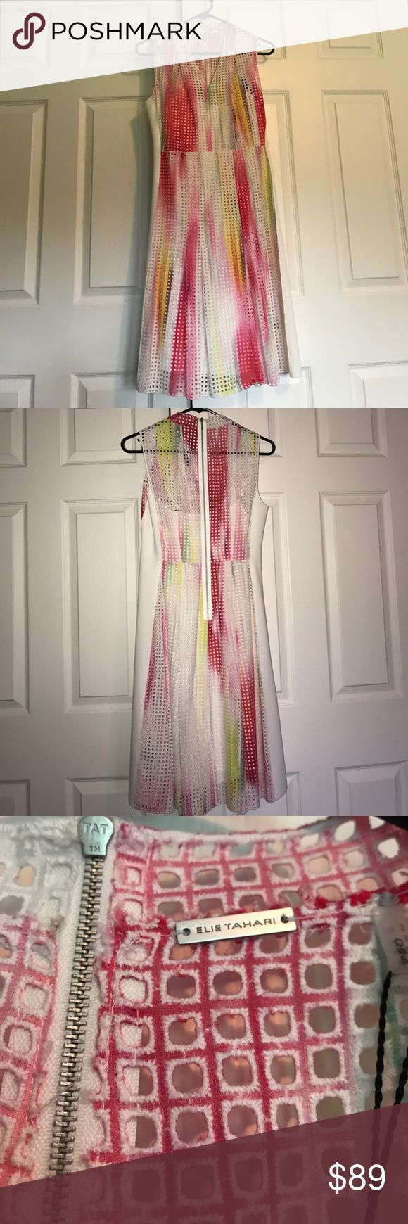 Elie Tahari Dress New with tags! 100% Cotton. Never been worn Elie Tahari dress. Comes in two pieces, a slip and the cover dress. Beautiful colors! 👗 Please feel free to reach out with any questions or concerns! May lower price through PP! Elie Tahari Dresses Mini