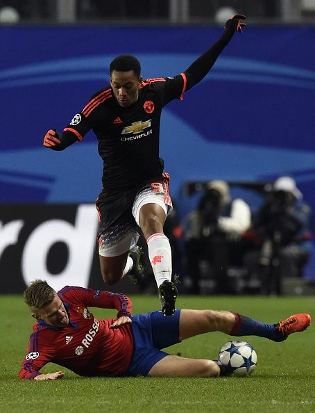 Manchester United's French forward Anthony Martial jumps over CSKA Moscow's Swedish midfielder Pontus Wernbloom during the UEFA Champions League...