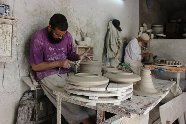 The potter moulds the clay. Its fascinating to watch as the shape forms. What skilled hands!