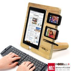 """woodDock is a wooden dock for """"i"""" devices, you can place iPad, iPhone, iPod together and turn them into a station of entertainment, work and charging . woodDock is a product from China, available at mygeek                                                                                                                                                     Mais"""