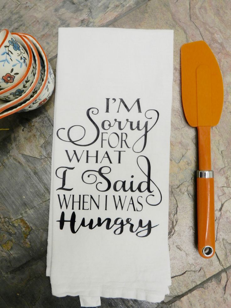 """Fun handmade flour sack tea towel.  The cute saying is """" I'm sorry for what I said when I was hungry"""" I have transferred the commercial grade black vinyl lettering by a commercial heat press onto the flour sack kitchen tea towel . The image measures 8"""" x 6.5"""". The white kitchen towel towel is made of 100 % ring spun very absorbent cotton. The towel is a very good quality and tightly woven."""