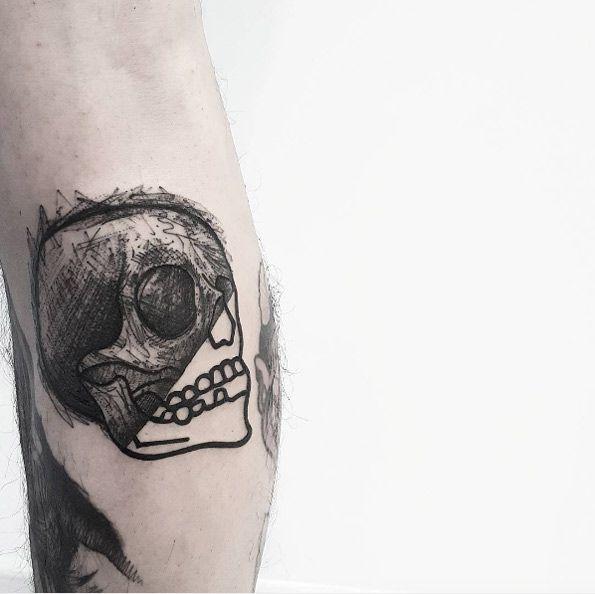Half-sketched skull tattoo by Matteo Nangeroni