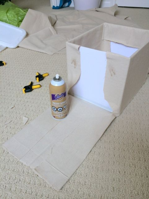Step 7 - use spray glue to to glue fabric to the storage boxes - northstory.ca