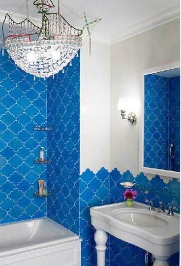 Blue arabesque tile.  Add a chair rail or pencil liner to the top of the wainscot to finish off