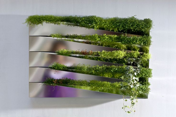 Вертикальное озеленение (58 фото) - интересный способ экономии пространства http://happymodern.ru/vertikalnoe-ozelenenie-58-foto-interesnyj-sposob-ekonomii-prostranstva/ Металлические цветочные контейнеры