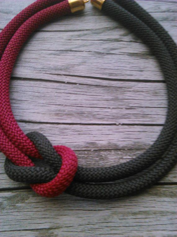 A braided burgundy and grey climbing rope necklace