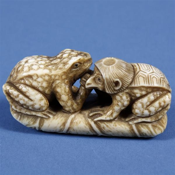 "IVORY NETSUKE - Kappa with toad. Katagori netsuke of a mythical figure ""Kappa"" seated with a garden toad on a rolled leaf."