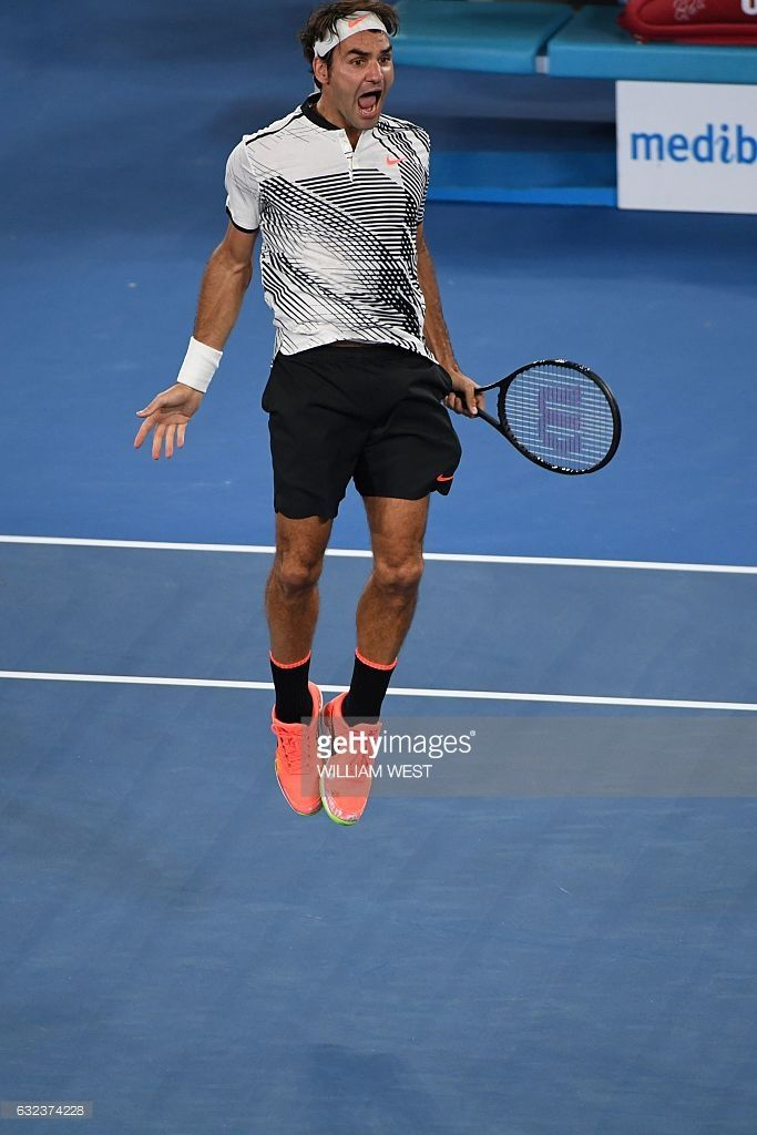 #Federer #RogerFederer #tennis Switzerland's Roger Federer celebrates his victory against Japan's Kei Nishikori during their men's singles fourth round match on day seven of the Australian Open tennis tournament in Melbourne on January 22, 2017. / AFP / WILLIAM