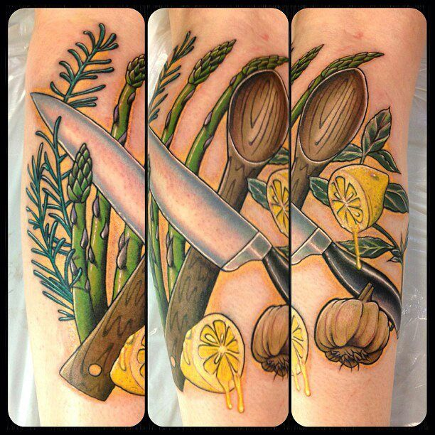 Culinary tattoo consisting of chef knife, wooden spoon, rosemary, asparagus, garlic, lemons, and thai basil. Done in one 8.5 hour session, location is left calf. Artist: Spiro Kambitsis of Artistic Impressions in Katy, TX.