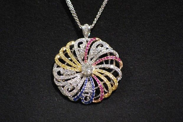 """Rosendorff """"World of Colour"""" Pendant. Designed and Created by Rosendorff Jewellers for the 2014 Ronald McDonald House charity ball auction. The money raised is donated to help seriously ill children and their families."""