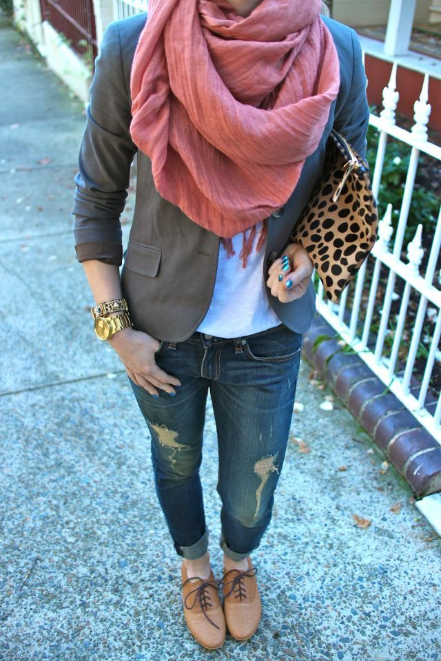 Brown lace up oxfords, slouchy distressed boyfriend jeans, gray blazer, rose pink scarf, chunky bracelets, big clutch