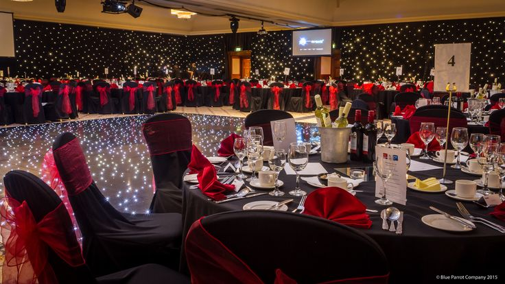 Burns Supper. Corporate event. LED dance floor. Black star cloth draping. Red ties. Black linen.