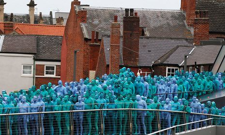 More than 3,000 people in east Yorkshire city were painted with four shades of blue paint before US artist photographed them