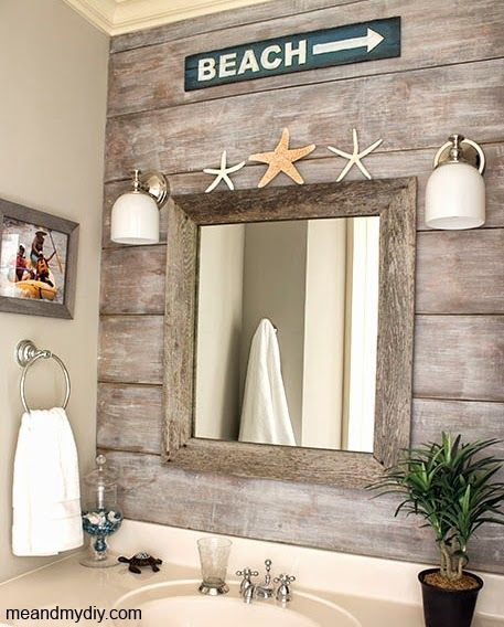 Beach bathroom with wood paneled accent wall.