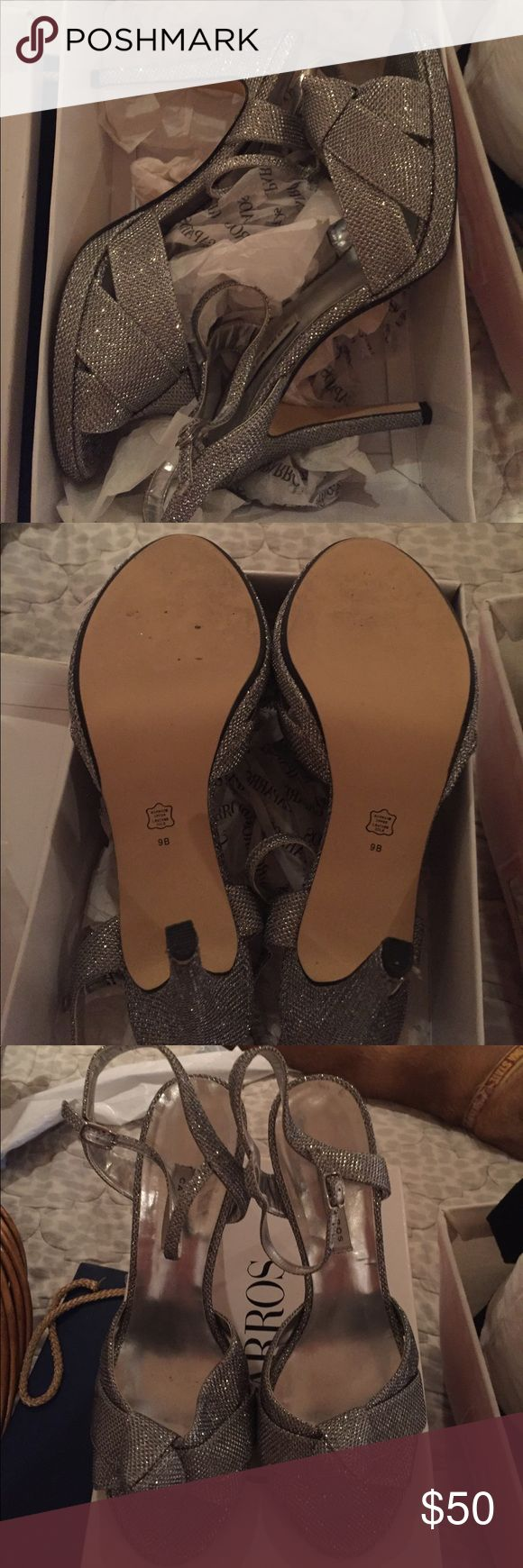 Silver Dress Shoes Worn for three hours - almost brand new and comes with box. silver sparkly dress shoes. About a 3 inch heel. Smoke free home. Barely any wear. Been kept in box. Size 9. Caparros Shoes Heels