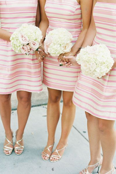 A preppy southern wedding featuring pink striped bridesmaids dresses
