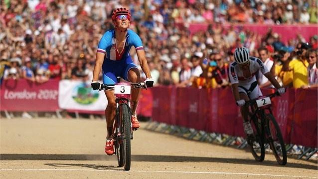 Jaroslav Kulhavy of the Czech Republic out paces Nino Schurter of Switzerland to win the men's Mountain Bike race