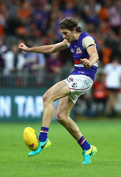 Marcus Bontempelli of the Bulldogs kicks during the AFL First Preliminary Final match between the Greater Western Sydney Giants and the Western...