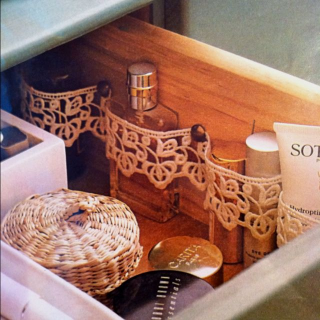 Pin a length of lace to inside of drawer, provides for extra support for bottles and tubes. Love this!