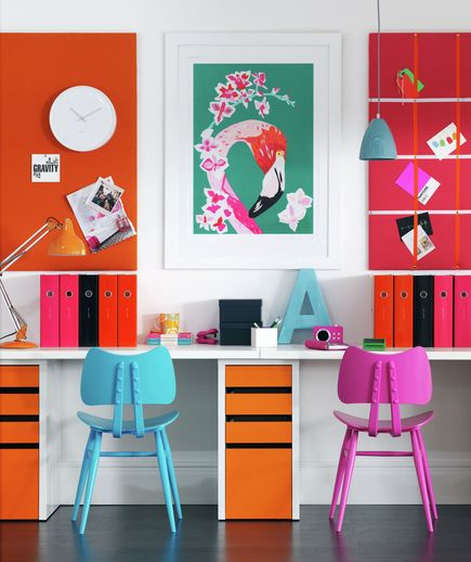 So I am looking for ideas for our home office/ guest room and while I don't think the colors work for us, the idea of dual seating and a streamlined, continuous desktop would work well in our room.