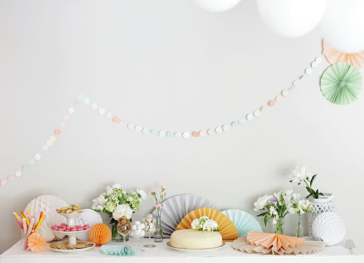 Circle garland, folded paper fans, macarons, flowers.