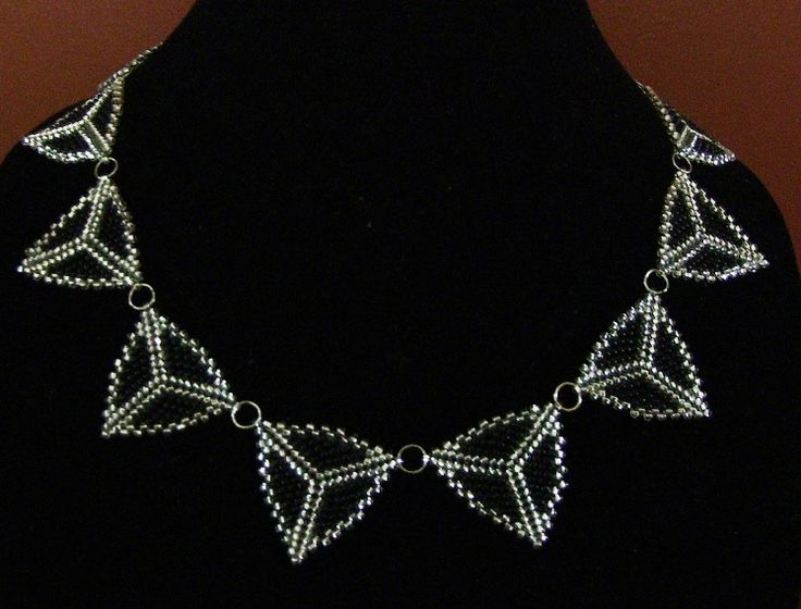 Silver and black peyote triangle necklace.    www.facebook.com/teristreasures