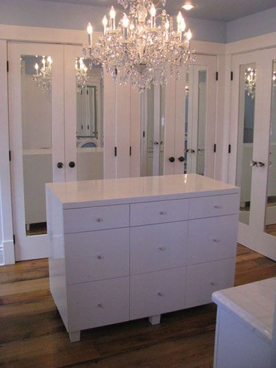 Turn a spare room into a dressing room.  Mirrored doors, center island & a chandelier <3