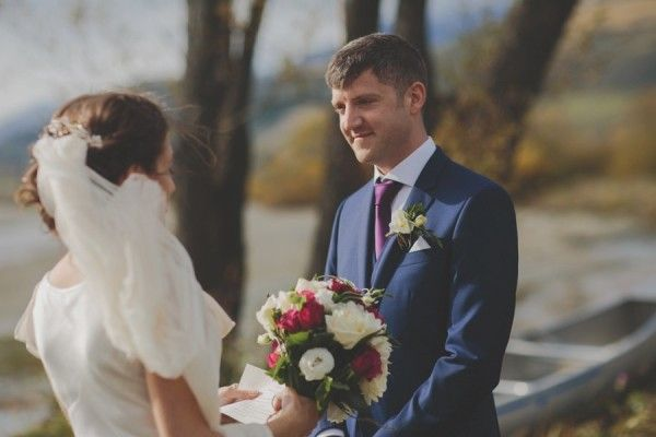 Husband and wife share personal promises to each other at their lakeside elopement in Glenorchy #elopement #glenorchy #glenorchywedding #queenstownwedding #newzealandwedding #realwedding #queenstown #brideandgroom #bride #groom #weddingceremony #weddingvows #promises #bridalflowers #bouquet #groomattire #weddingdress #bridaldress #veil #autumnwedding #fallwedding #outdoorwedding #queenstownmarriagecelebrant #yourbigdayqt #yourbigdayyourway #lovemyjob