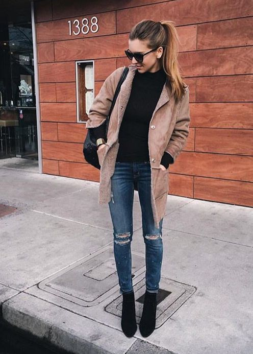 Distressed skinnies, shearling coat, black turtleneck, and ankle boots.