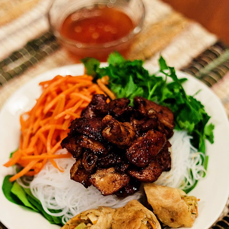 Vietnamese Pork Noodle Bowl Recipe Salads, Main Dishes with brown sugar, fish sauce, soy sauce, sesame oil, garlic, lemongrass, ginger, chili sauce, green onions, pork butt roast, rice vermicelli, romaine lettuce, english cucumber, matchstick carrots, beansprouts, mint leaves, chopped cilantro, roasted peanuts, dipping sauce, water, fish sauce, fresh lime juice, rice vinegar, sugar, thai chile, garlic, matchstick carrots
