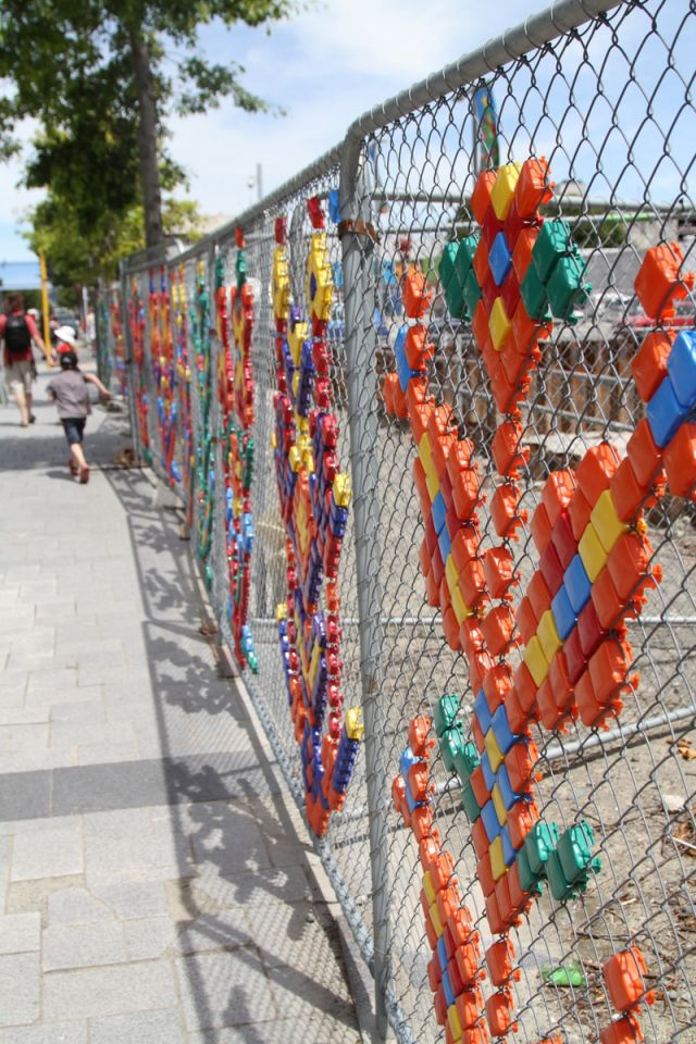 Making a boring wire fence full of colour and interest. Christchurch, NZ.