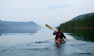 Early morning paddle on the calm waters in Gwaii Haanas, Haida Gwaii, Canada.